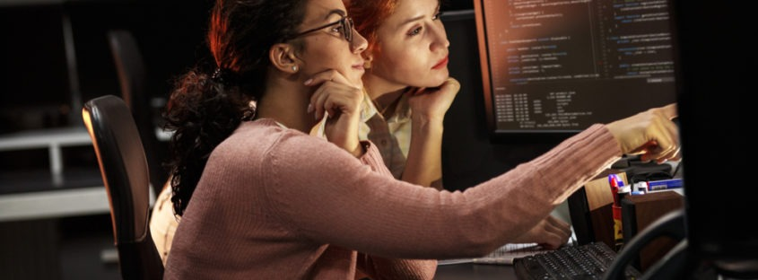 women programmers at computer collaborating